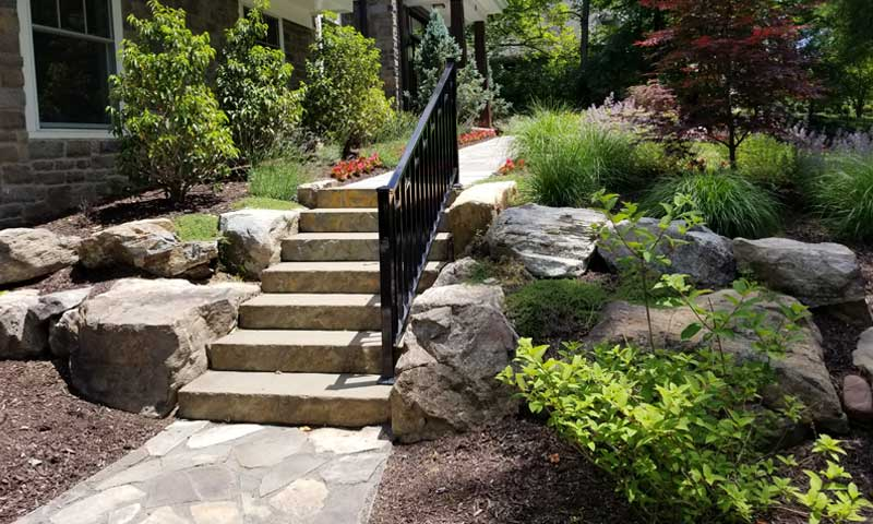 hardscape-path-to-front-door-with-greenery-and flowers