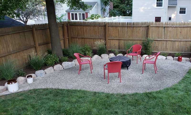 backyard-gravel-patio-with-outdoor-seating-and-firepit
