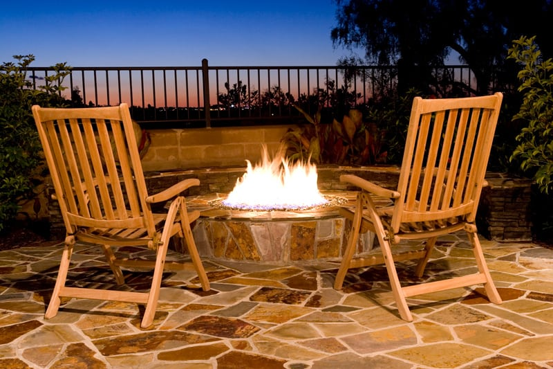 Stone Fire Pit and Two Chairs on Patio