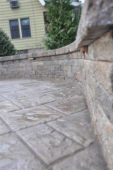 Hardscaping example of driveway pavers and retaining wall