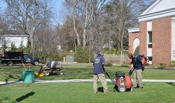 Landscapers doing commercial property maintenance