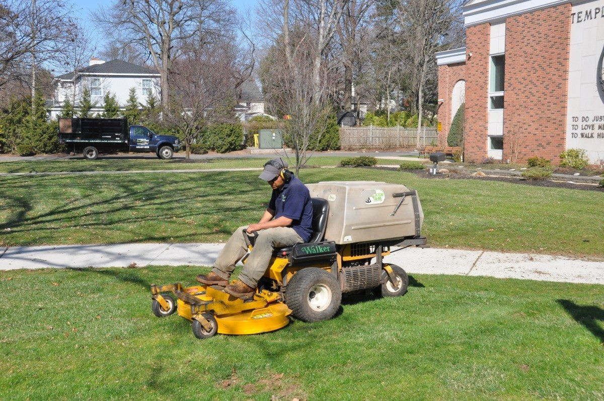 landscaper mowing commercial property
