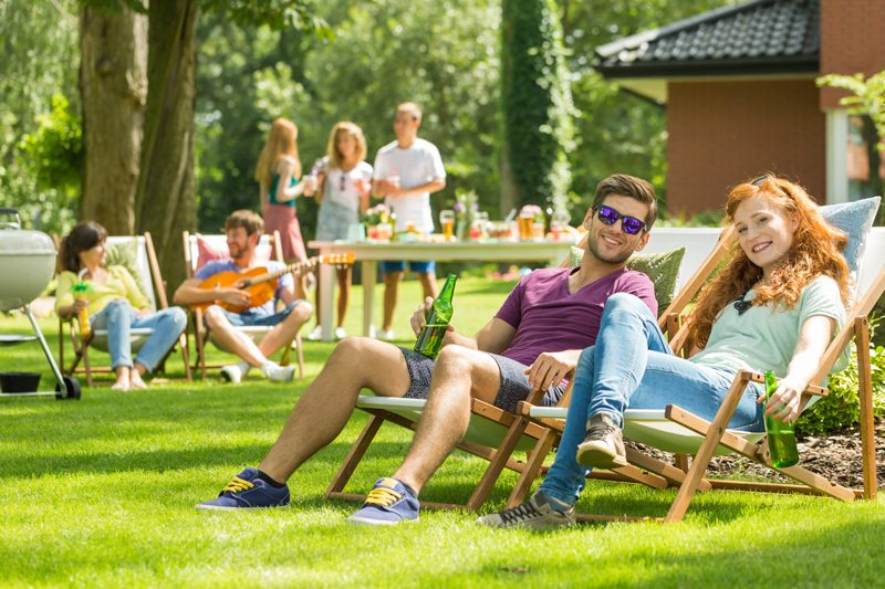 Couple in Lawn Chairs Enjoying Summer Weather